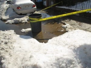 Example of water main leak in roadway