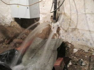 Example of water main leak at foundation