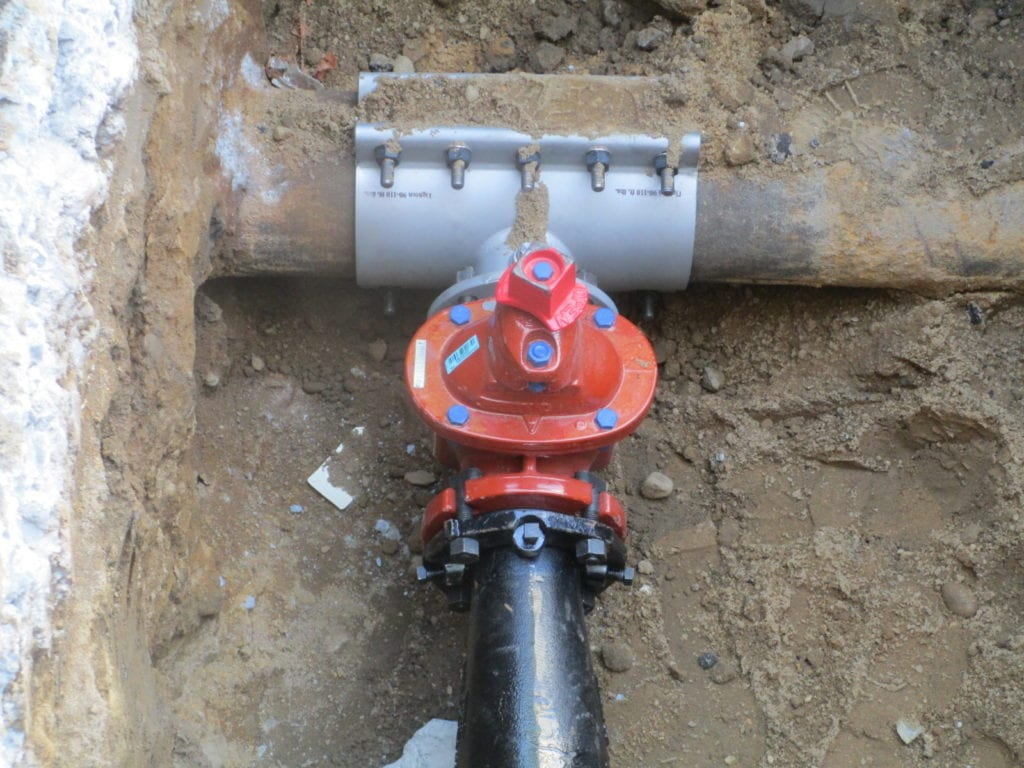 Wet connection for combined water main