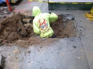 Excavating for water main installation