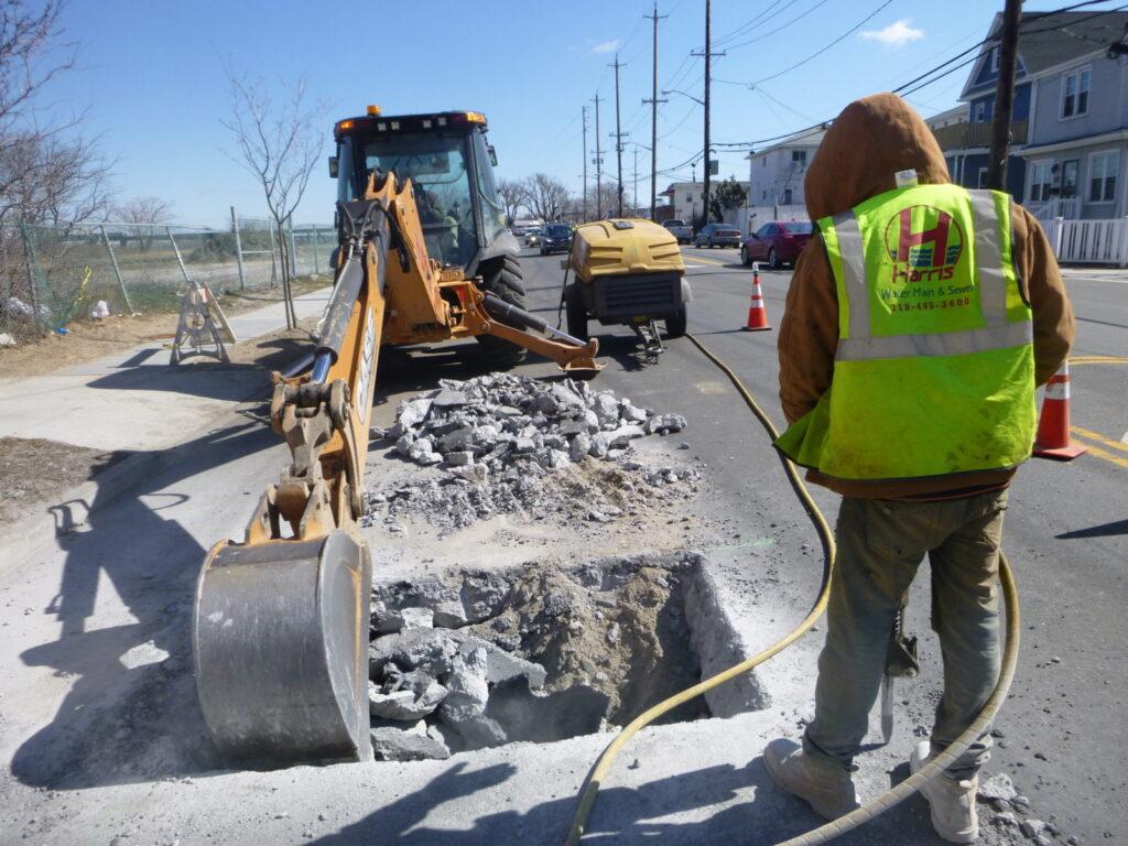 Digging for sewer repair in roadway