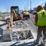Digging for sewer repair in roadway