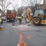 Jack hammer roadway for sewer repair