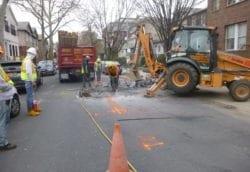 Jack hammer roadway for sewer repair