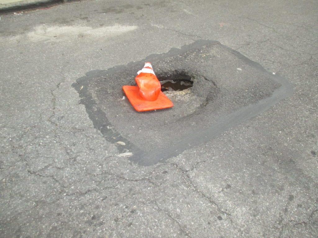 Roadway sinkhole from water leak