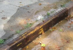 water main leak on sidewalk