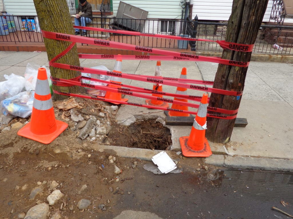 utility pole installed through sewer line