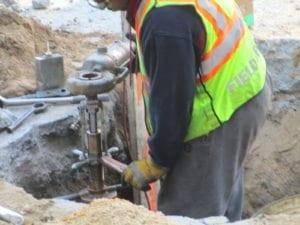 DEP installs new water main tap