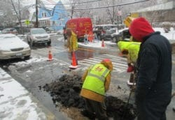 Digging to repair broken water main from cold weather