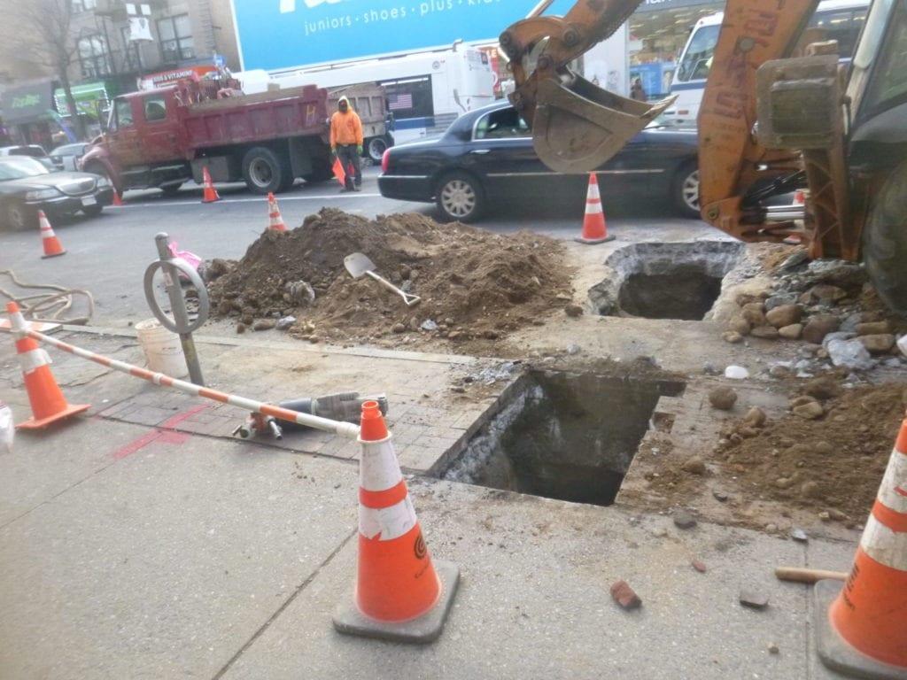 Excavating around utilities for new water main