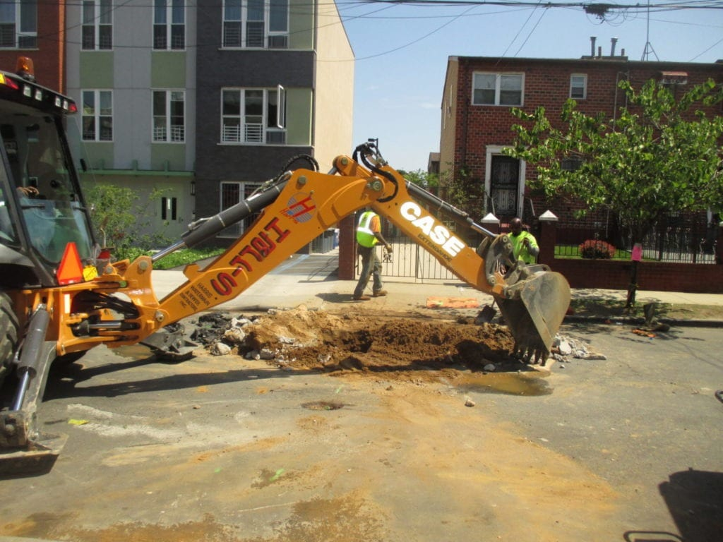 Excavating over city main