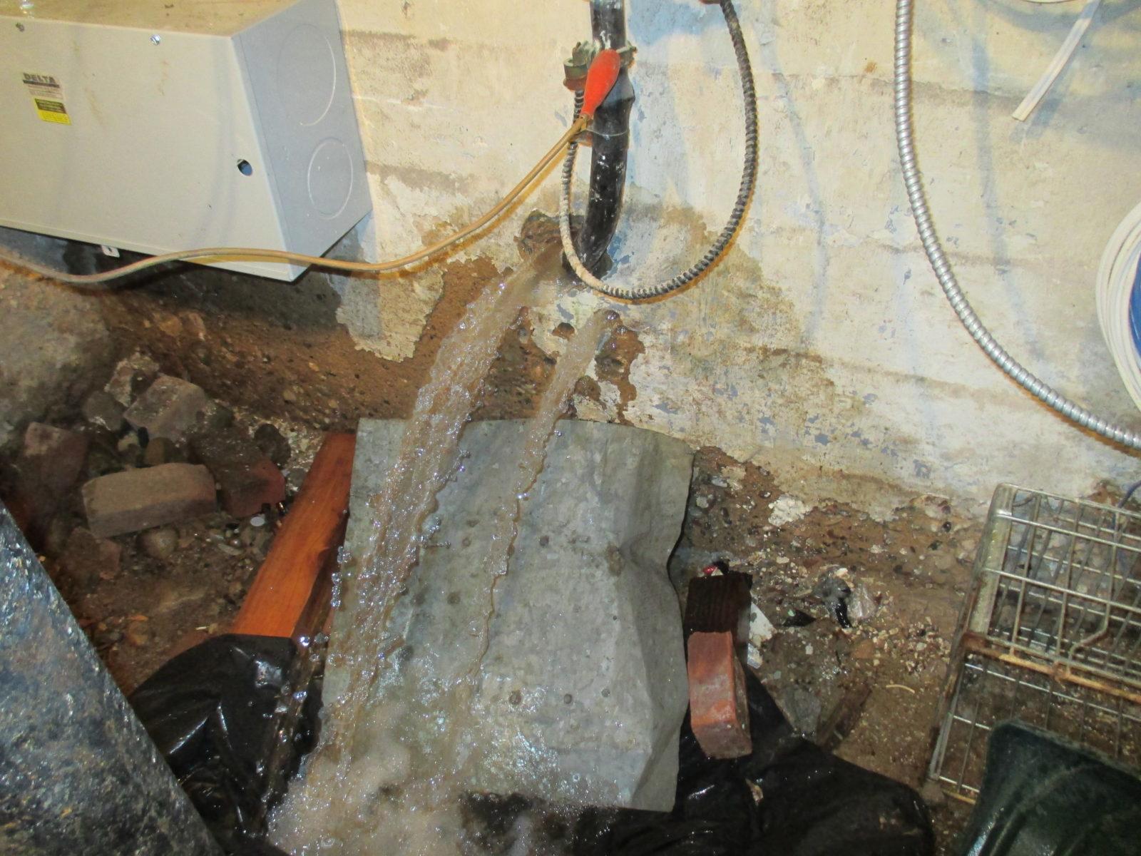 Water Main Leaks Under Sidewalk And