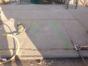 Sidewalk marking for new water main