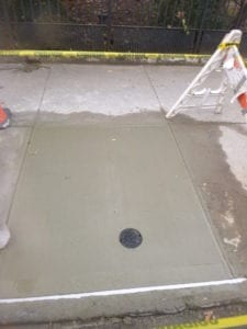 New curb box cemented in place
