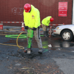 Jackhammer street for water main repair