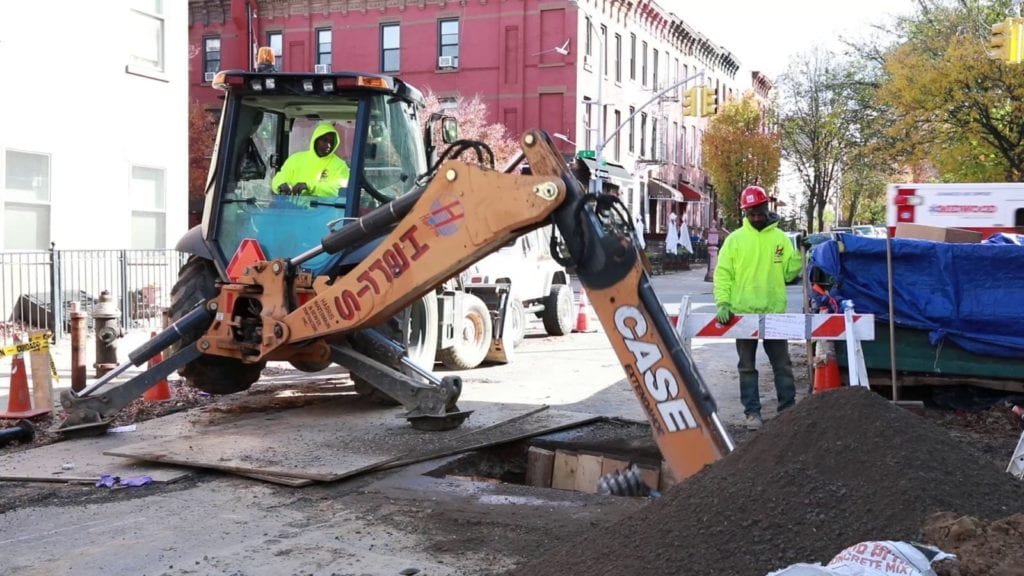 Sewer repair excavation with backhoe