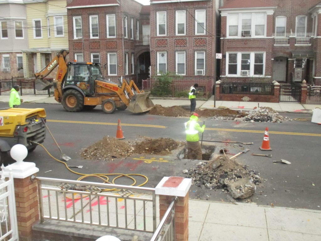 Installing water main from opposite side of the street