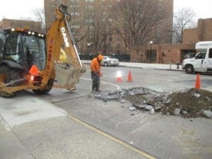 jackhammer roadway for new tap