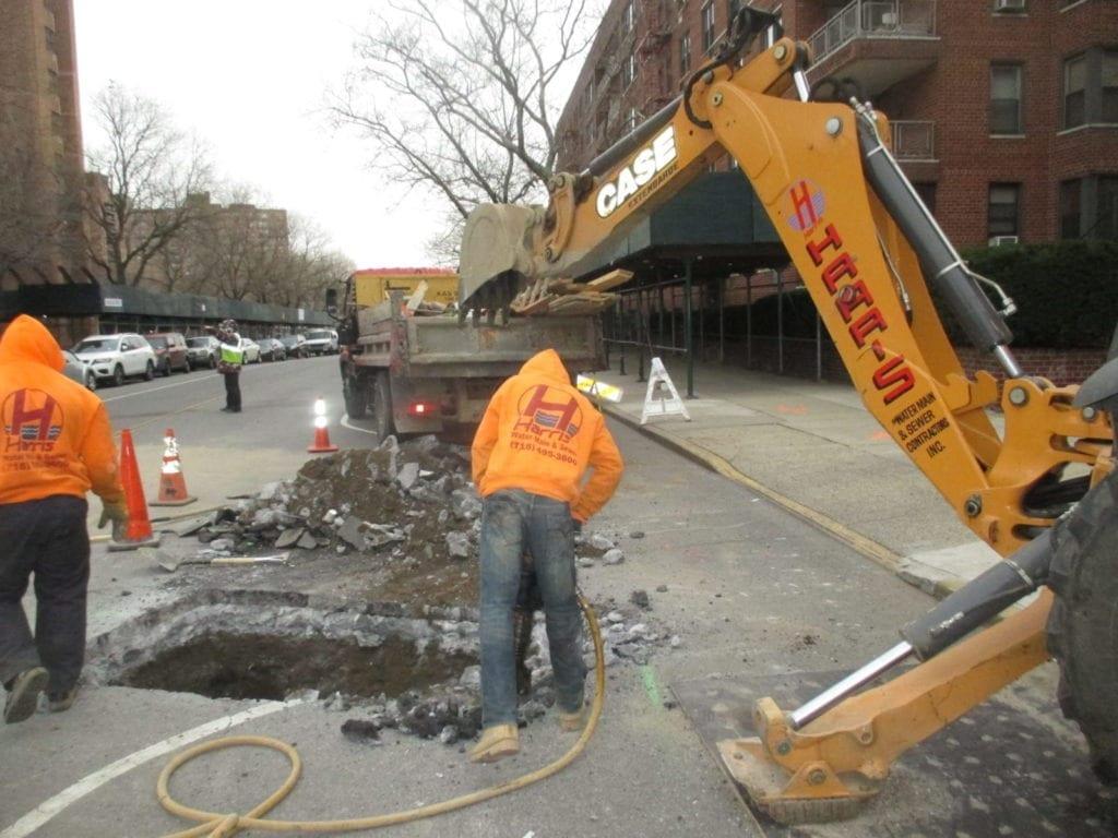 Preparing roadway in Manhattan for water main repair