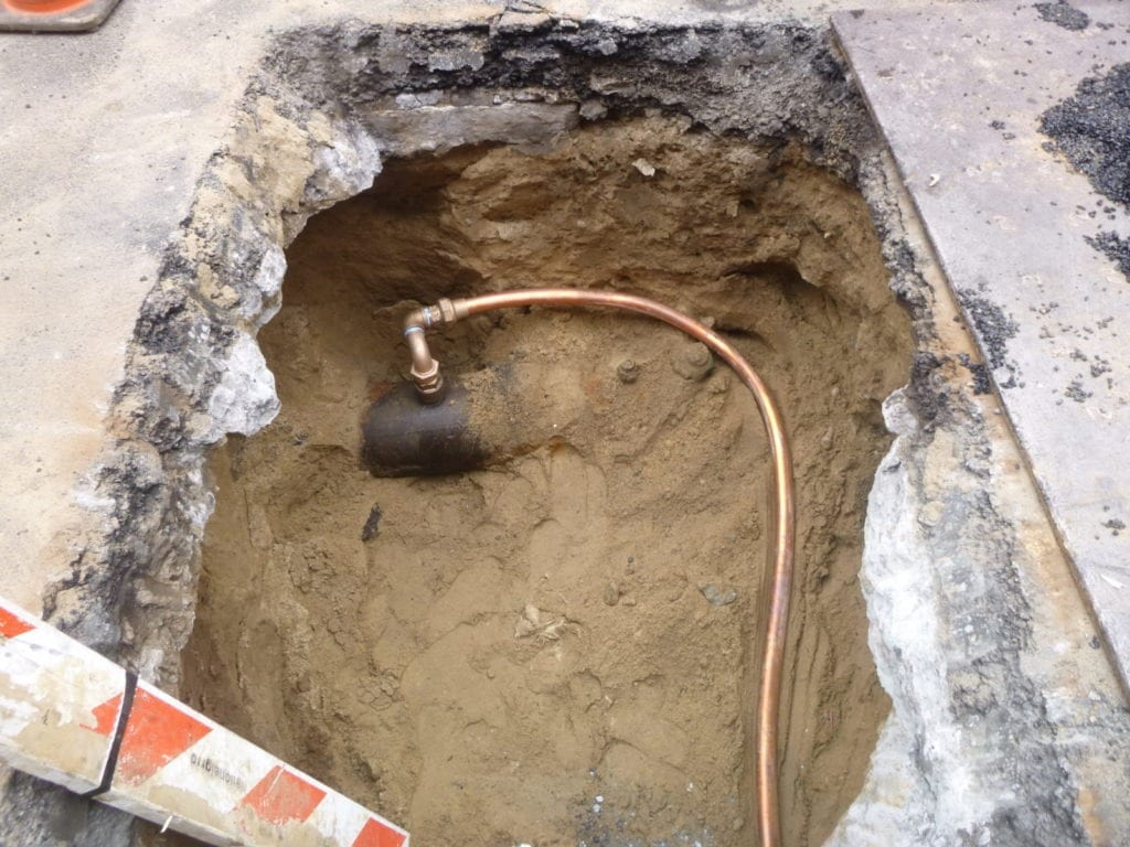Water main and tap connection to the city main