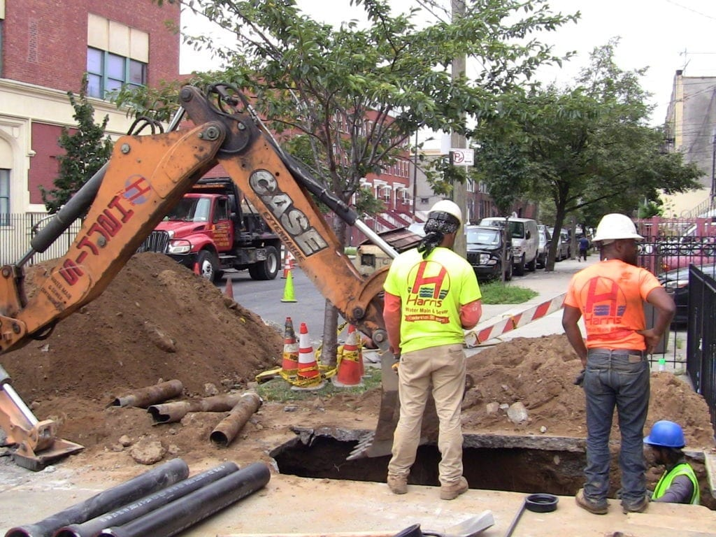Sidewalk excavation for sewer repair