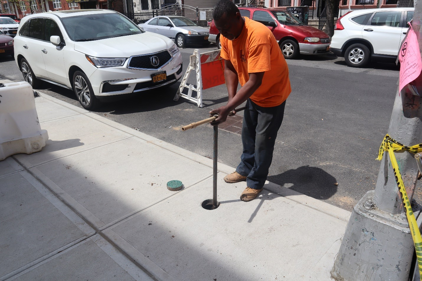 Man using a curb valve that is broken