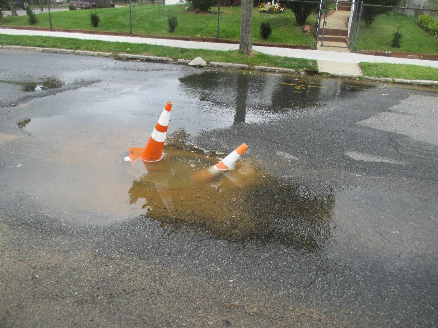 sprinkler leak in NYC roadway