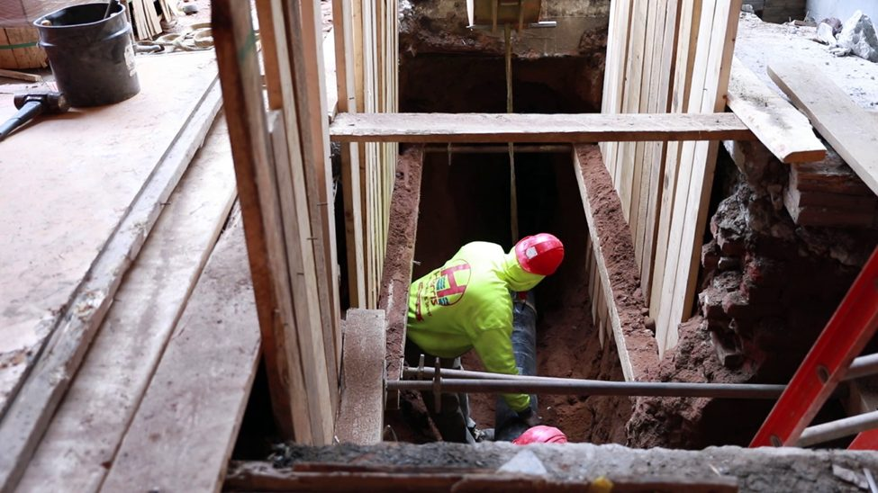 Harris Water Main and Sewer contractor working on a house sewer installation