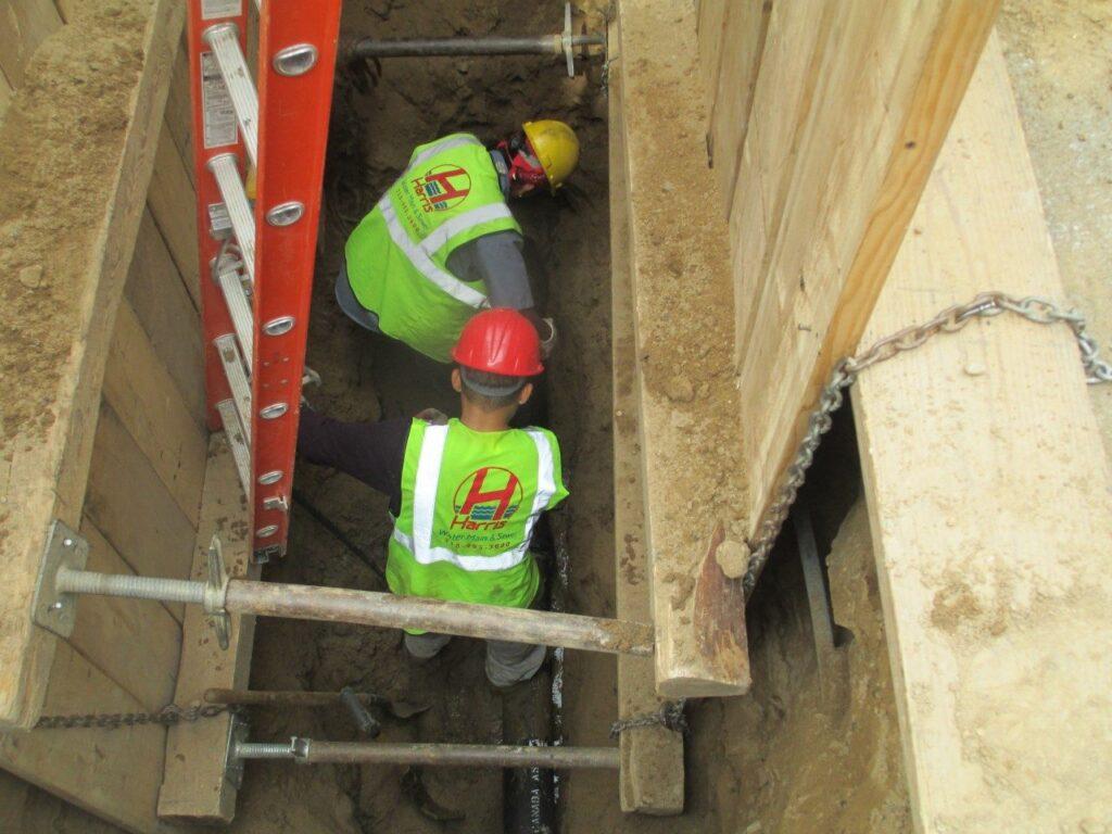 Installing new sewer line under street