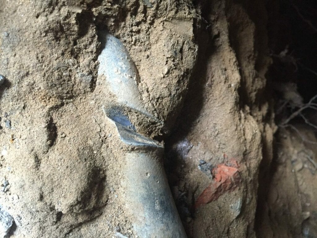 Lead water main with indent